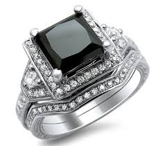 silver and squared black diamond ring